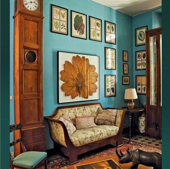 antique furniture antique wall art against teal wall