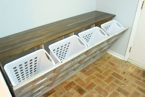 brown dresser repurposed into a laundry basket holder