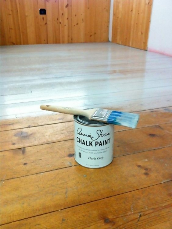can of chalk paint with paint brush on top