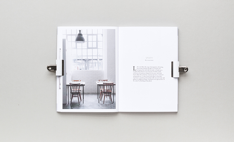 inside of read cereal magazine is a picture of a table and light with chairs