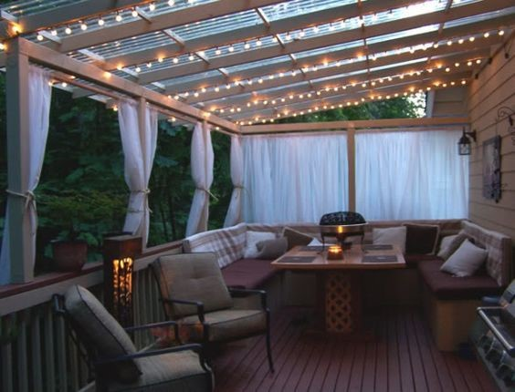 enclosed deck with string lights