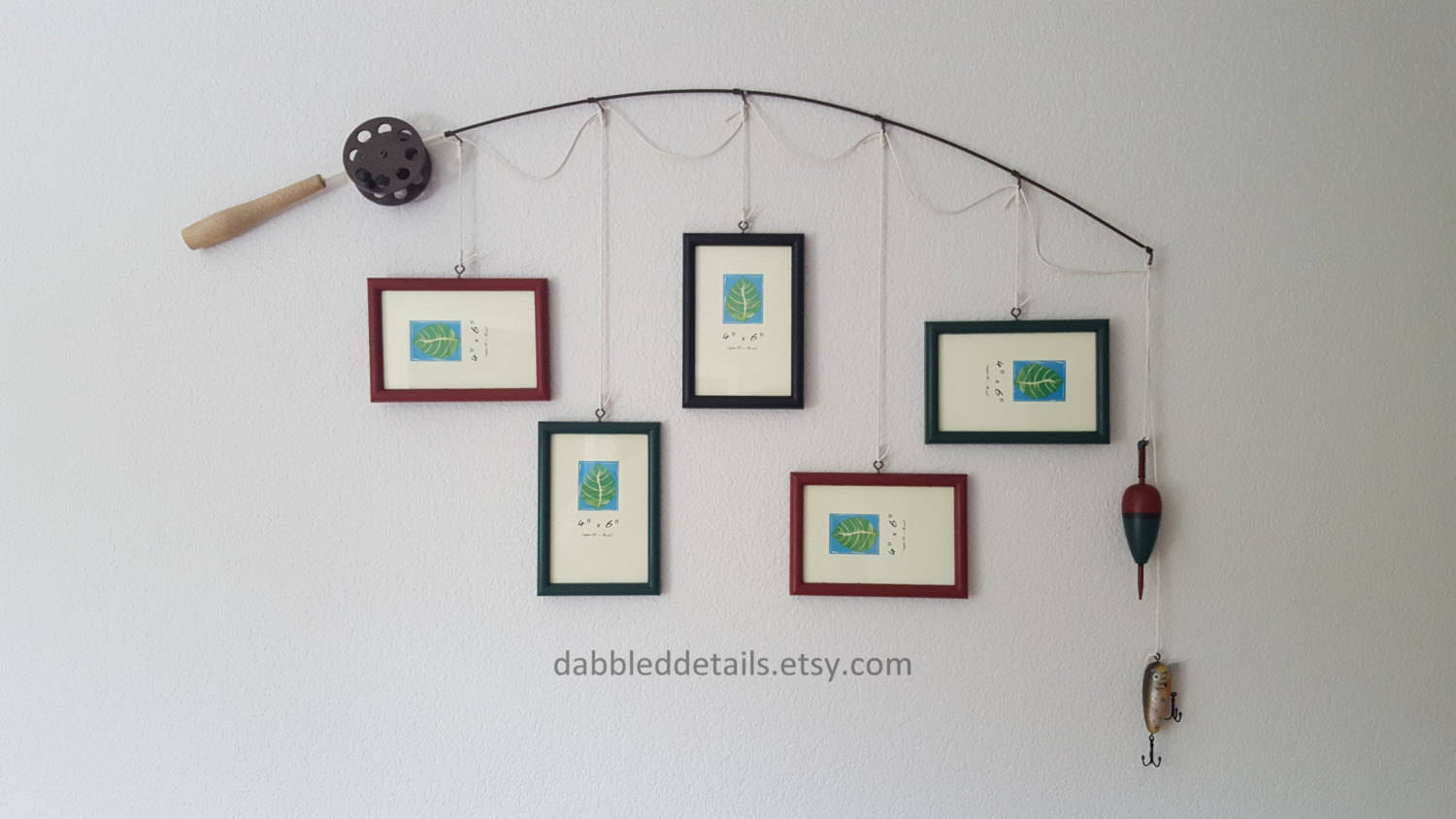 Fishing pole frame on wall with pictures