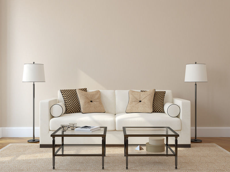 living room with white couch and two lamps