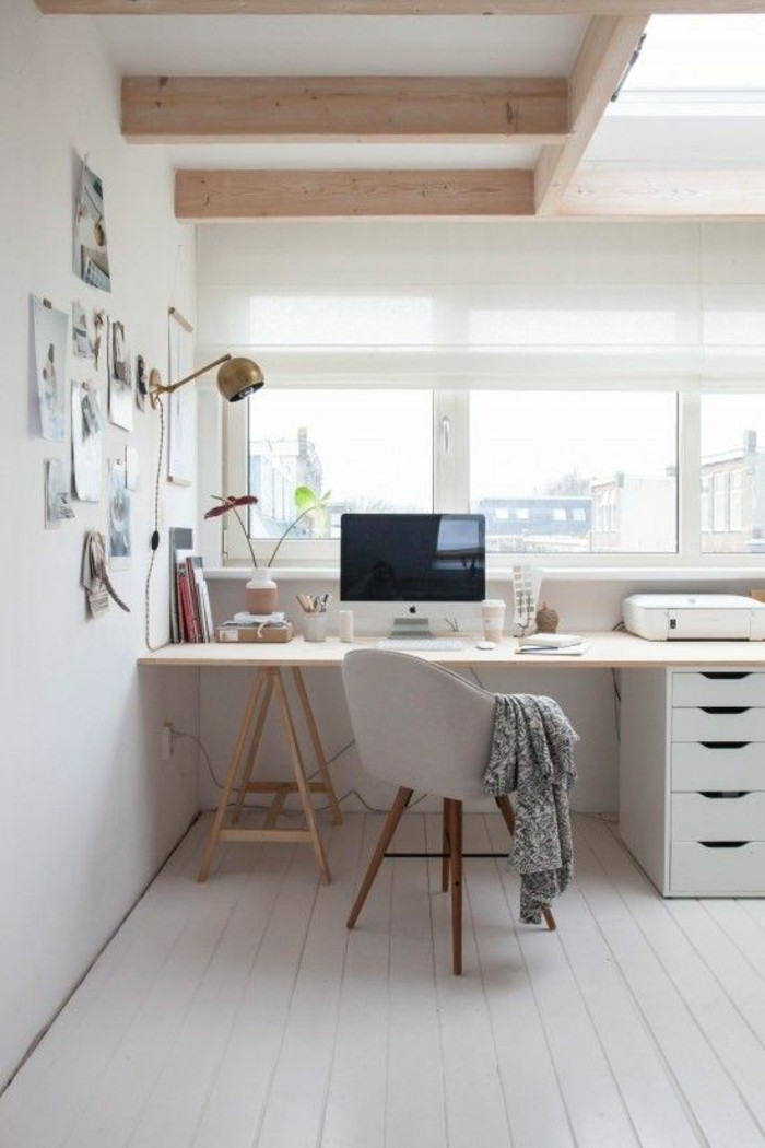 Office space with white walls and white desk with chair