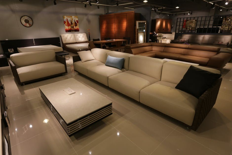 large family theatre room with several seating options and marble floor, large luxurious room