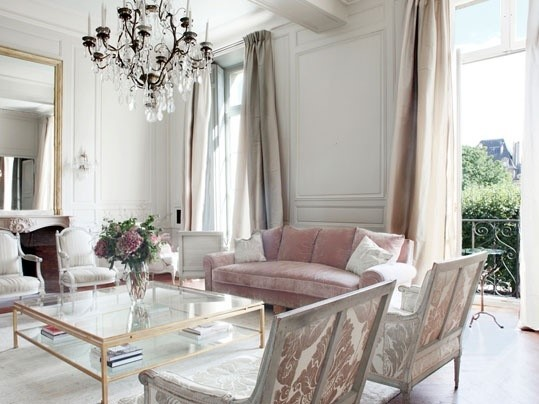 long luxurious drapes in front of large window in home