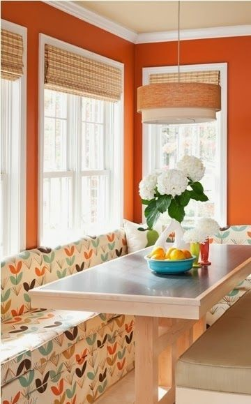 orange wall paint against white sofa with with orange accents