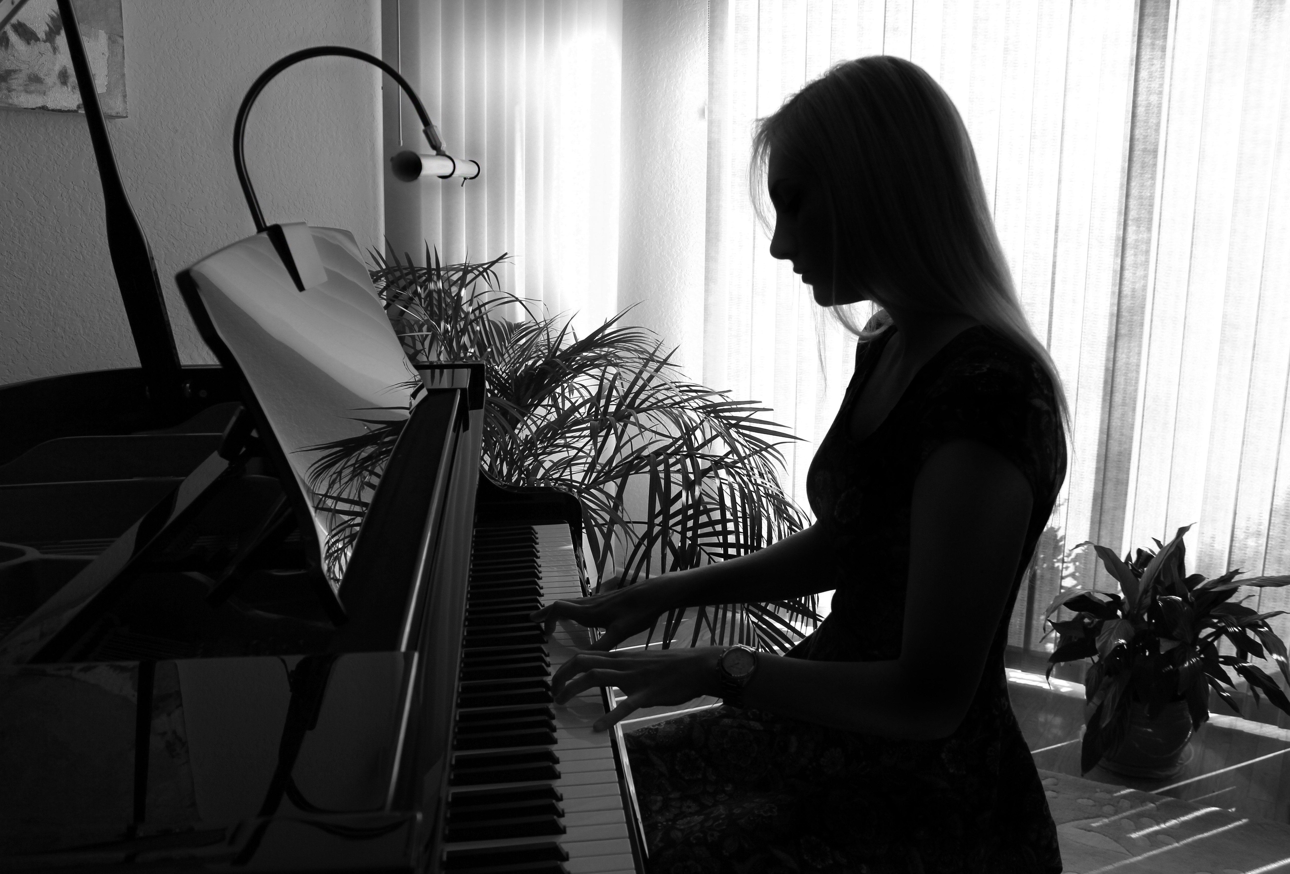 woman playing piano in the dark