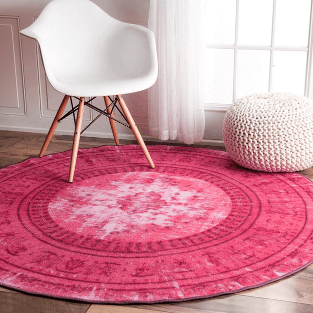 pink rug with white chair