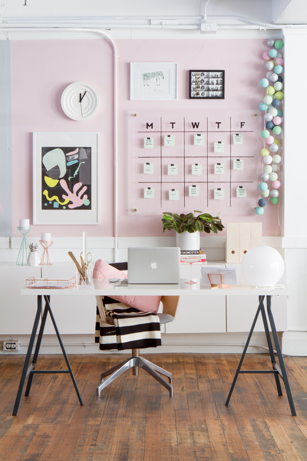 Office with pink wall and desk with chair