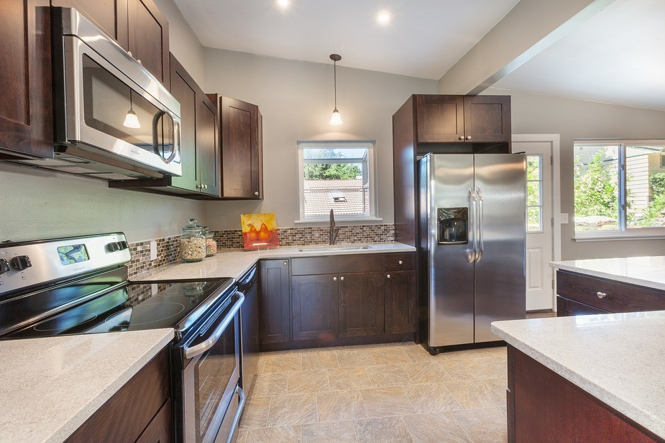 quartz countertop kitchen with brown cabinets