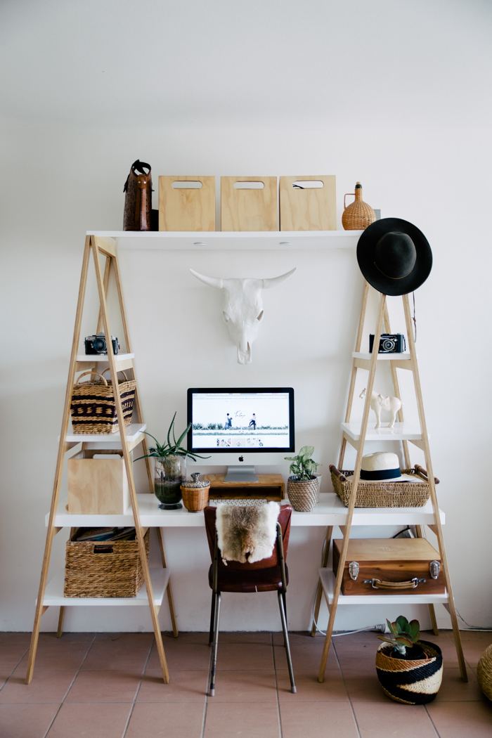 Office desk with white wall and racks