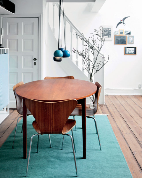 Kitchen table with teal rug