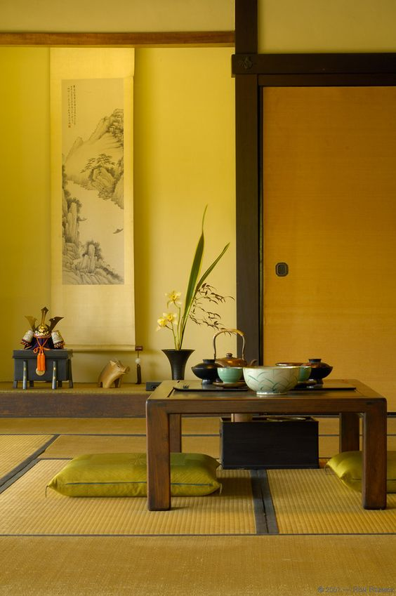 Japanese style yellow room with plant and coffee table