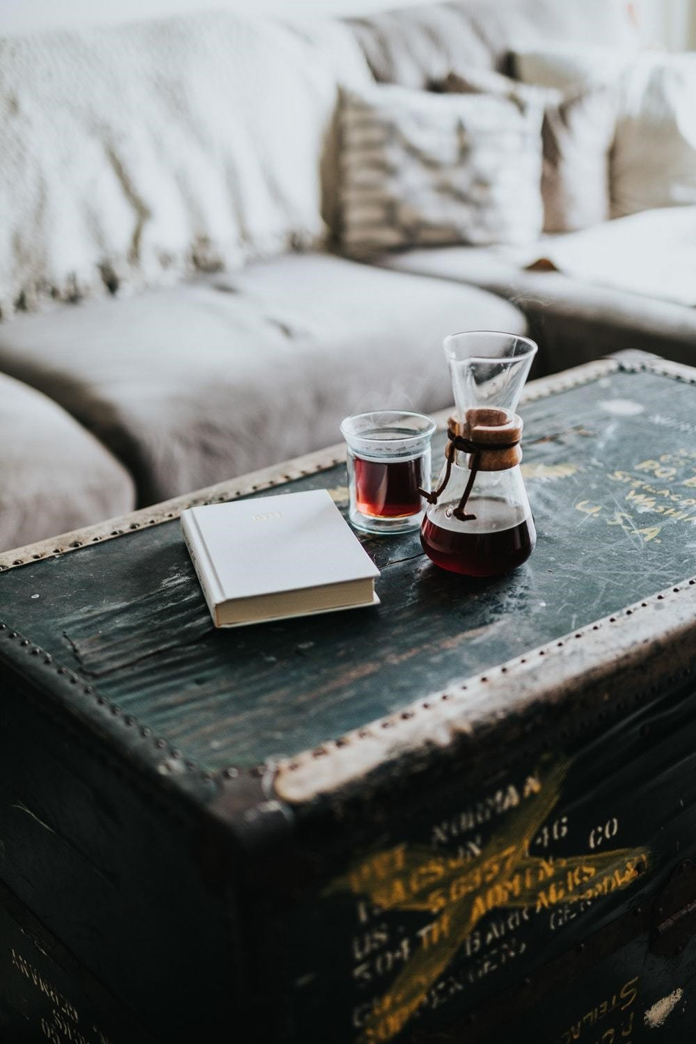 rustic old chest coffee table with wine and a book