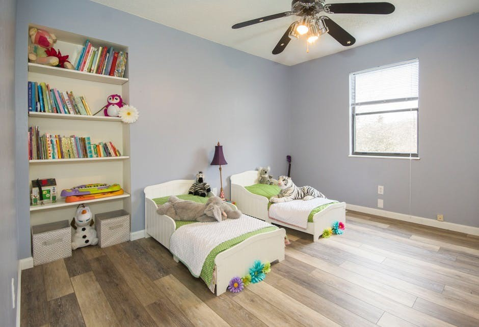 small kid beds in large open room