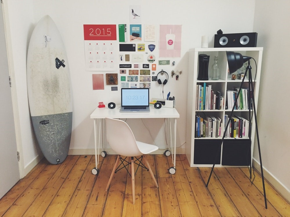 surfboard white wall office desk space