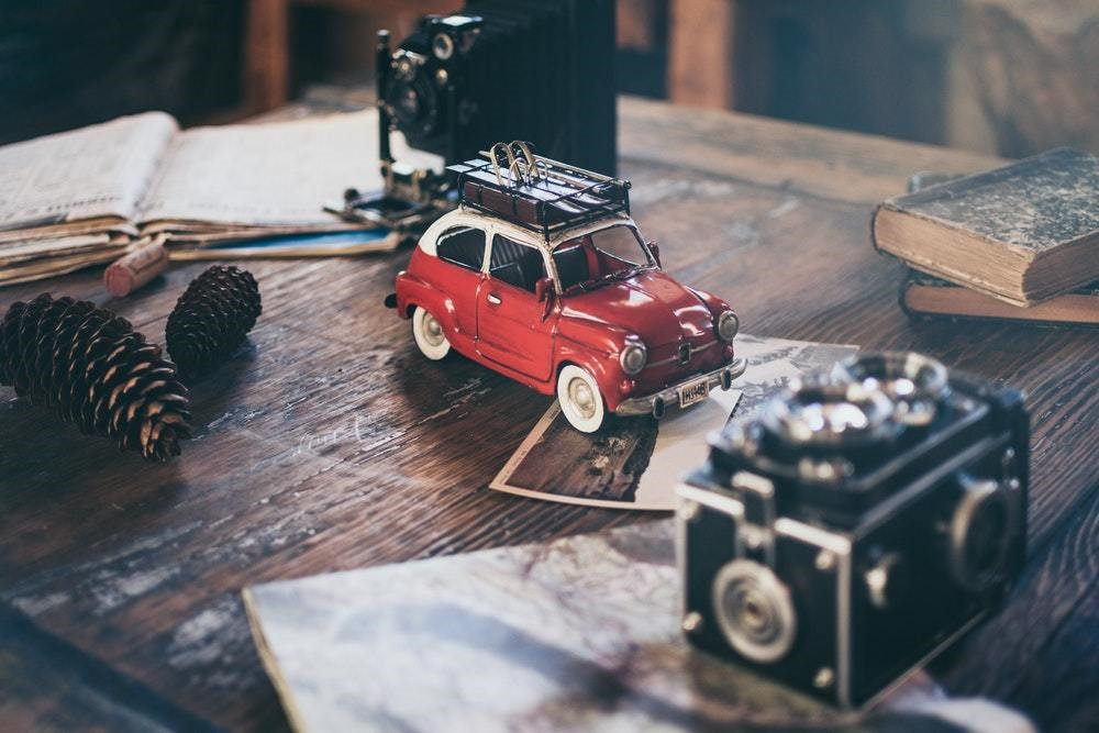 vintage red car on old table