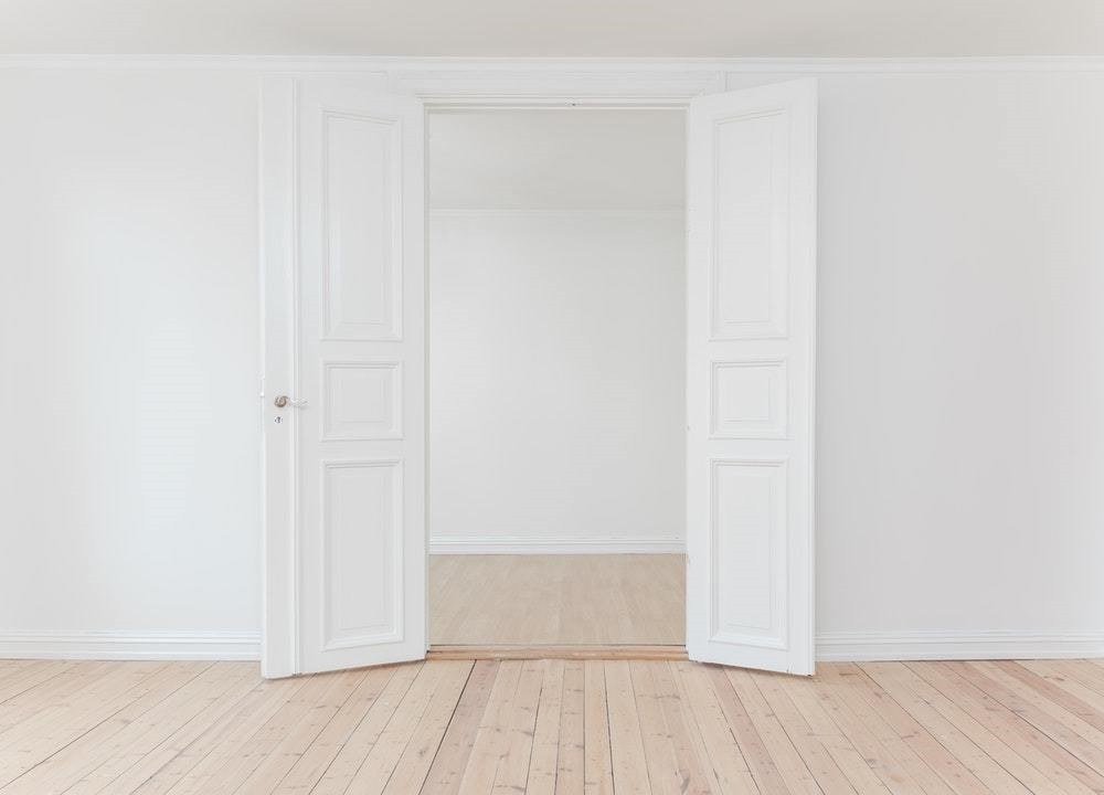 white new closet with plain wood floor
