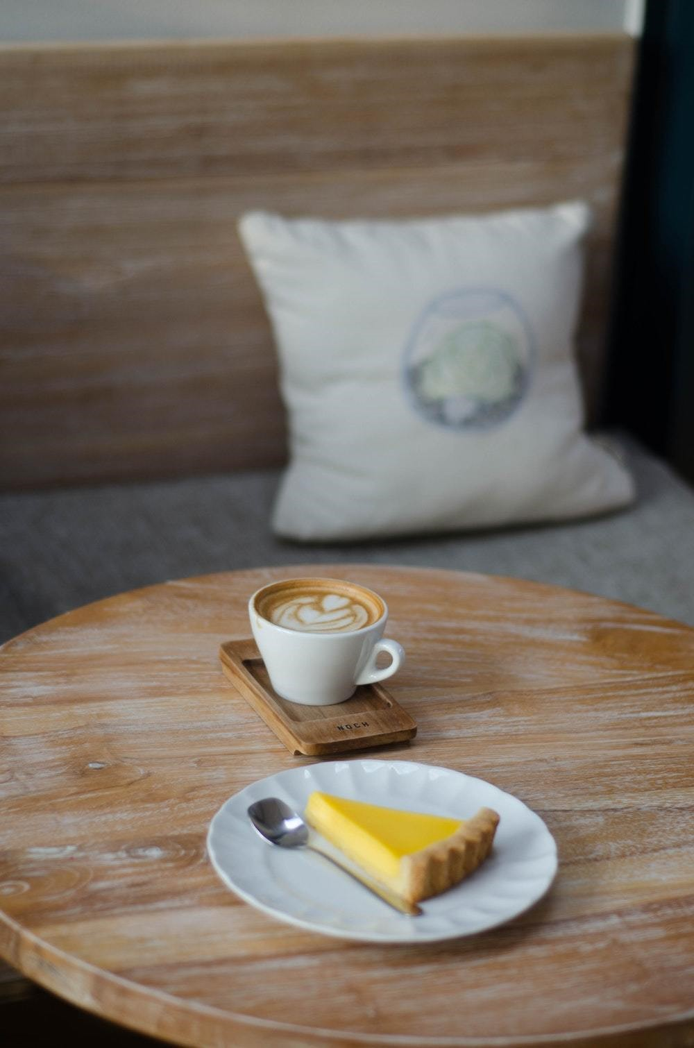 wooden coffee table with coffee and pie
